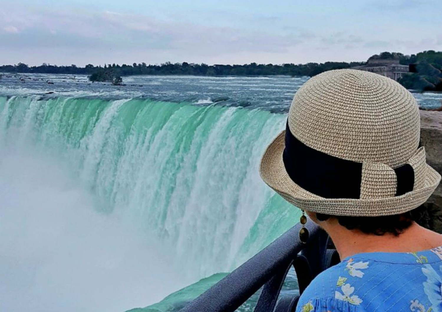 Lady looking at Niagara Falls Canada.