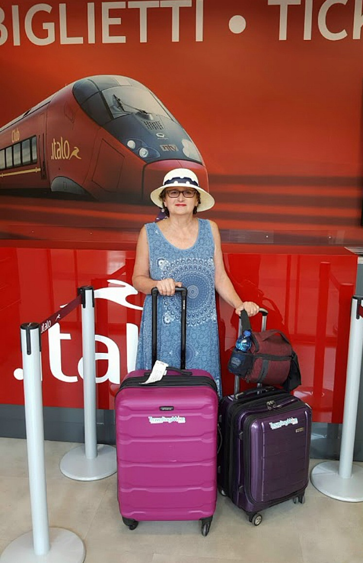 Benefits of travel. Author at the train station in Florence Italy.
