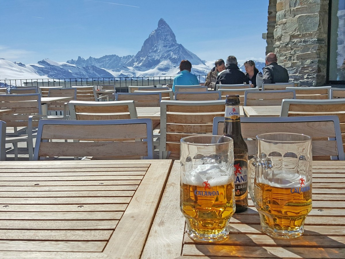 How to visit Zermatt. View of the Matterhorn and two glasses of beer.