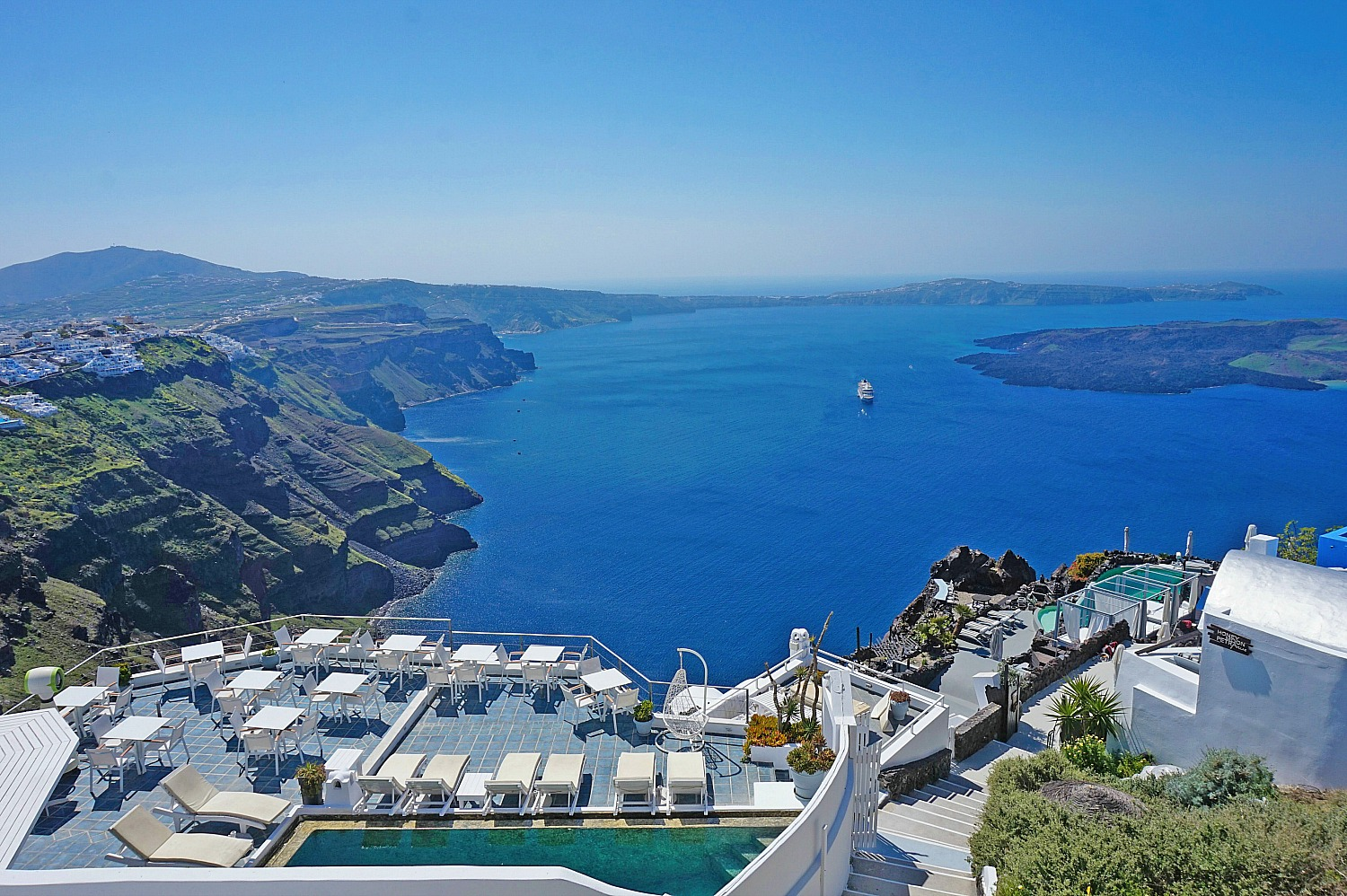 Why to stay in Imerovigli Santorini - a sun terrace overlooking the caldera.