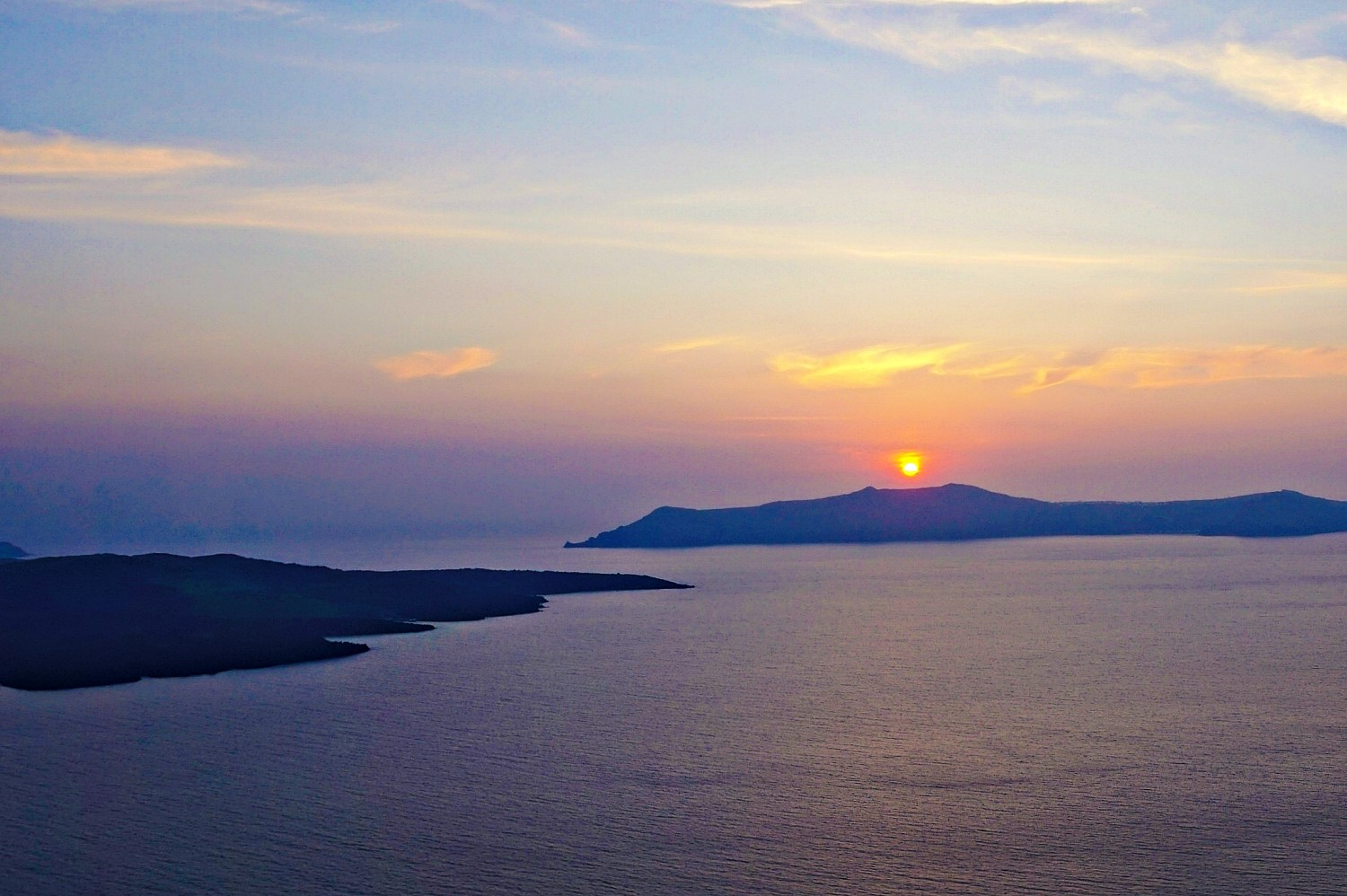 Why to stay in Imerovigli Santorini - beautiful sunset.