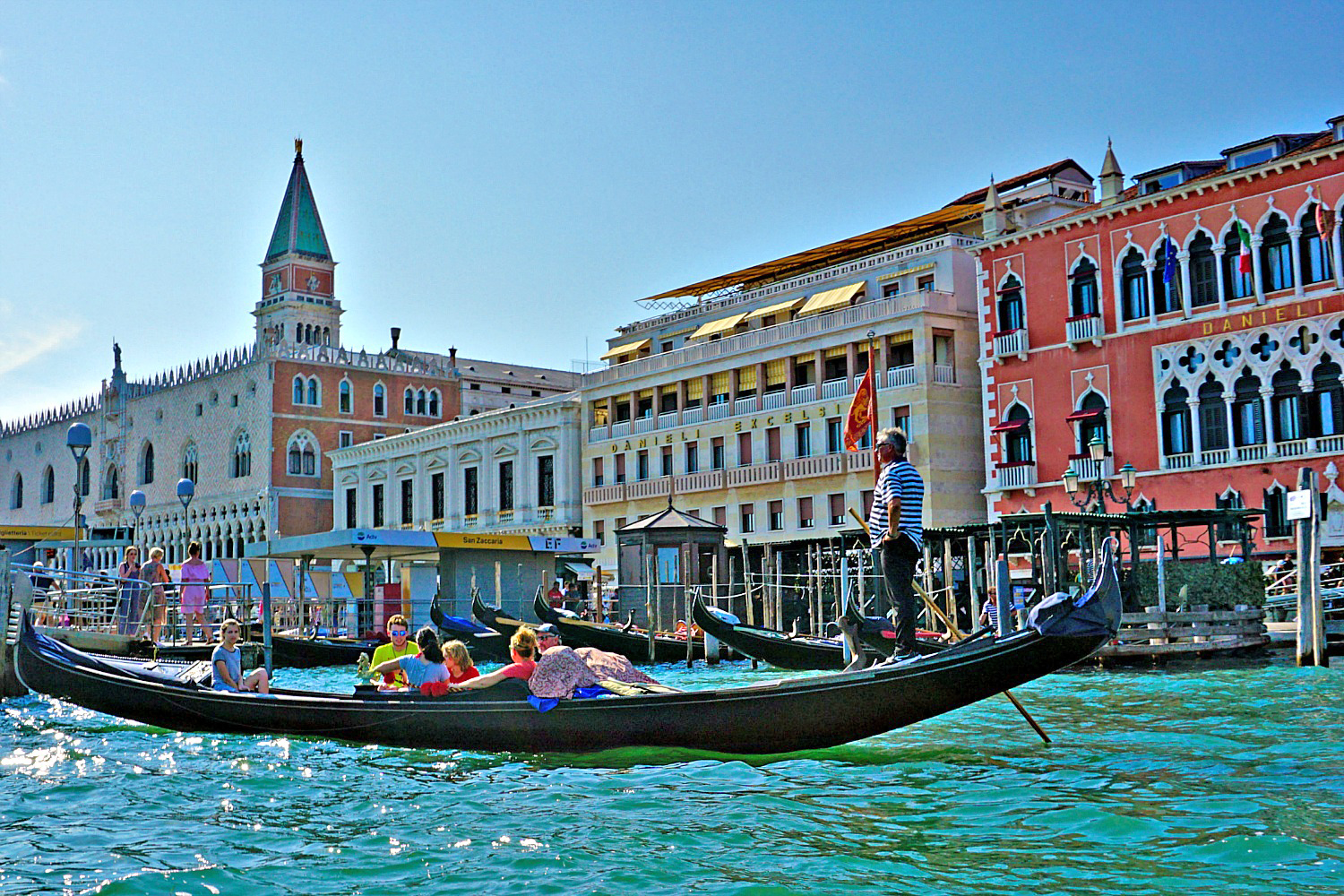 Venice gondola with tourist enjoying the ride.