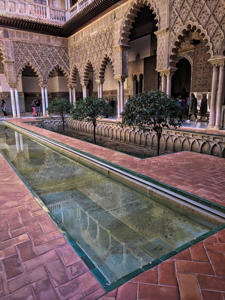 Alcazar Seville. courtyard with a pool.