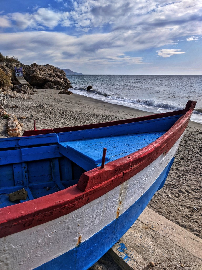 Holidays to Nerja Spain. Boat on the beach.