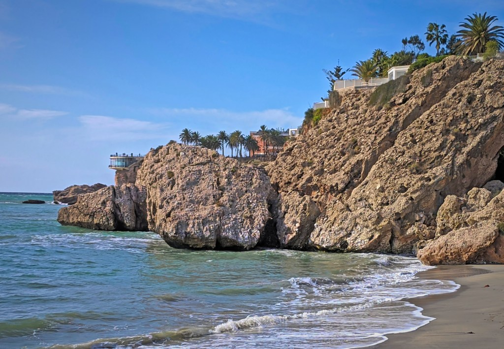 Beaches in Nerja Spain. A distant view of the Balcony of Europe.