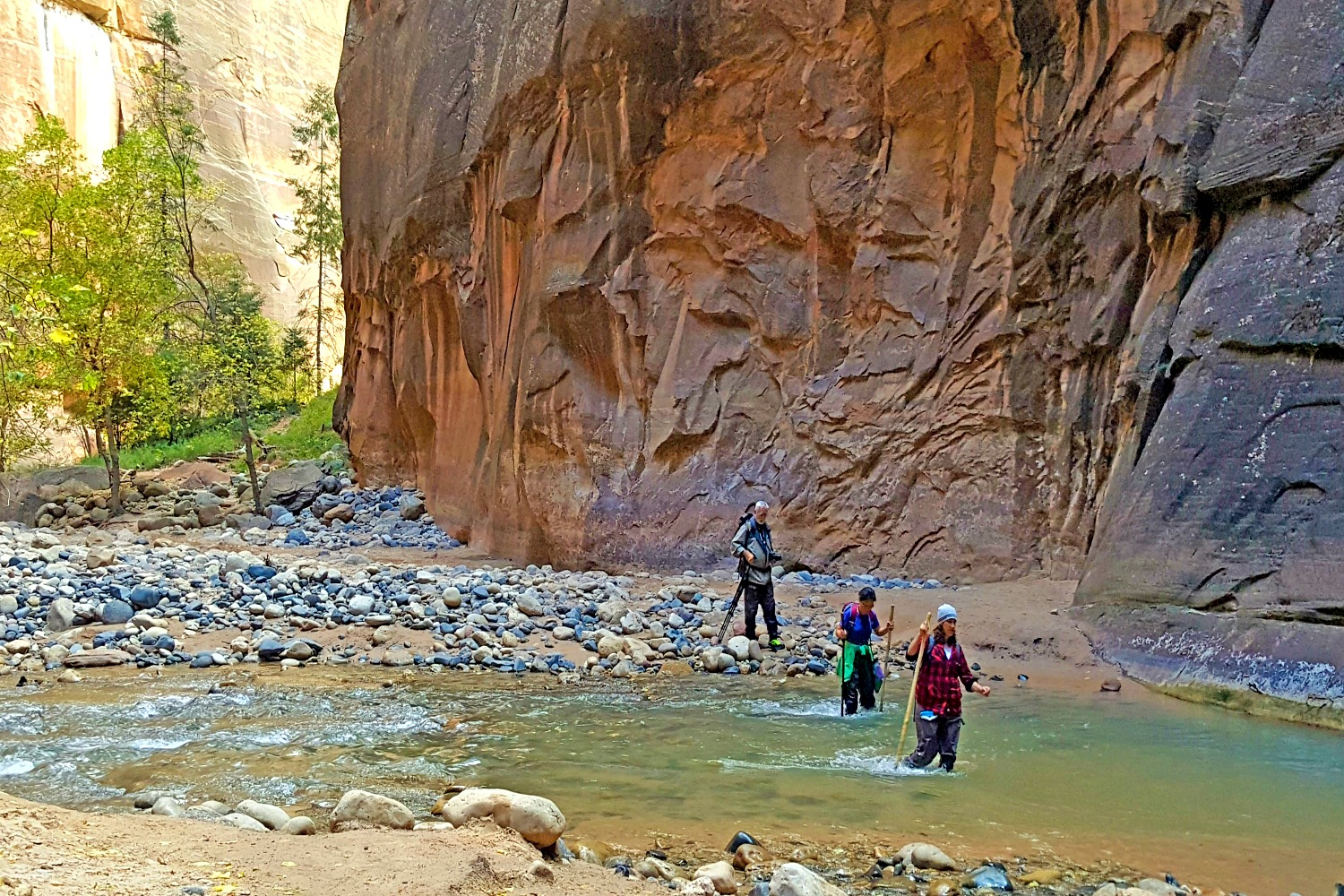 The Narrows in Zion. My friends walking back to the river after a short dry stretch