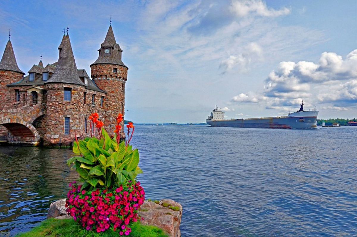 1000 Islands New York. Boldt Castle and a cargo ship.