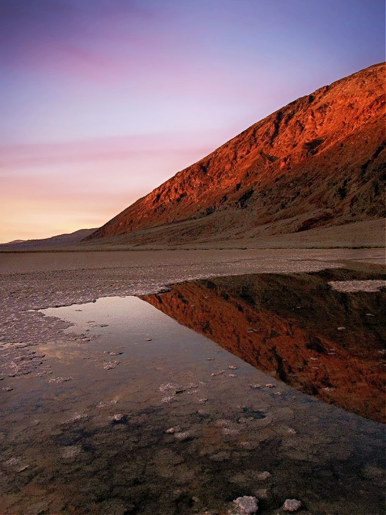 Sunset at Badwater Basin in Death Valley National Park.