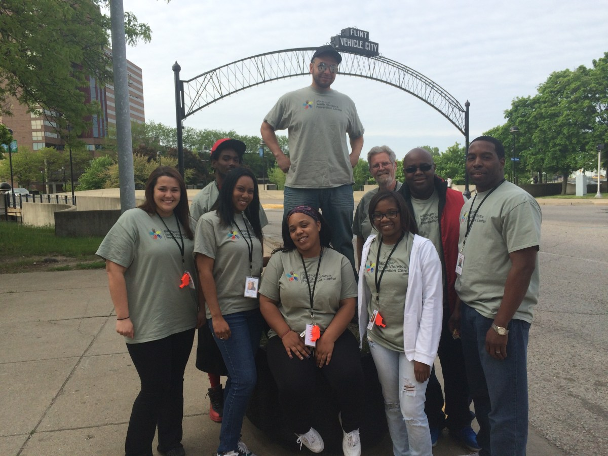 A picture of the MI-YVPC 2015 property assessors in front of the Flint arch over Saginaw Street, Flint, MI.