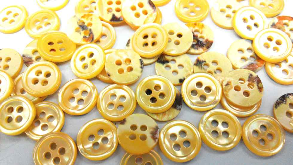 dyed yellow pearl shirt buttons