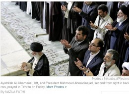 The Ayatollah seems to be praying, but he is also delivering a sermon. He refuses to hold another election, despite protesters.