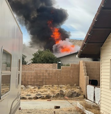 CHILDREN RESCUED FROM HOME FIRE THURSDAY