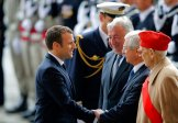 New French President Emmanuel Macron greets Claude Bartolone, second right, President of the National Assembly, during a a ceremony at the Arc de Triomphe in Paris, France, Sunday, May 14, 2017. (AP Photo/Michel Euler, POOL)