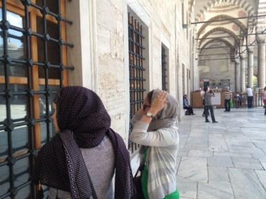 Preparing to enter Sultanahmet Mosque