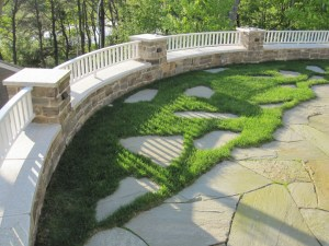 Fragmented bluestone treads in lawn grade allowing access to the perimeter wall seating areas
