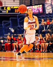 Senior guard April Robinson gets off a pass in Sunday's contest against #25 St. John's. Photo credit Ed Thompson