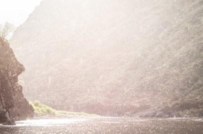 Alan and Lee Paddling Along as the Sun Breaks Through the Rain