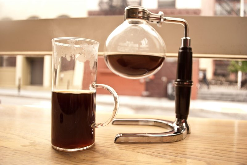 photo of siphon-brewed coffee on a windowsill in San Francisco