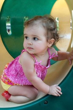 Milly on the playground at Greenfield Lake on her first birthday