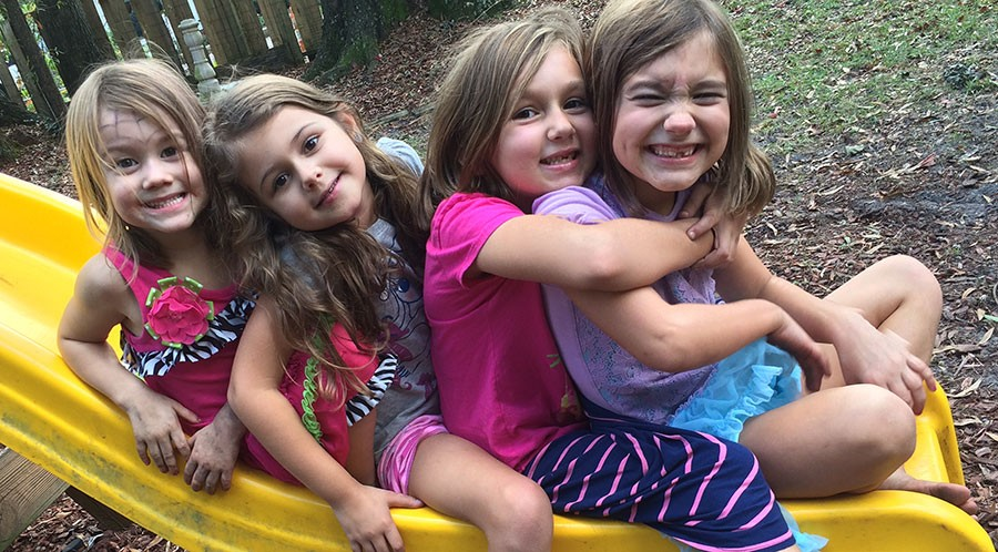 Adeline-Milly-Zoey-Penelope-on-a-Slide