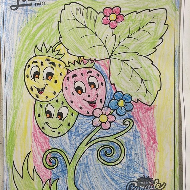 #Meliamae and I stopped by the grocery store the other day and saw her artwork hanging up there. She didn't know they had put it up. She told me the colors of the strawberries represented their lifecycle.