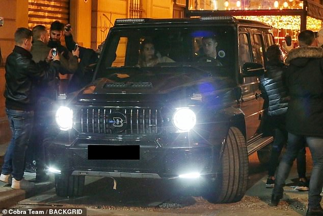 Main man> Fans gathered to take pictures of the sporting icon as he prepared to pull away