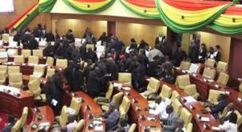 Fight Erupts in Parliament As MPs Push Each Other To The Floor