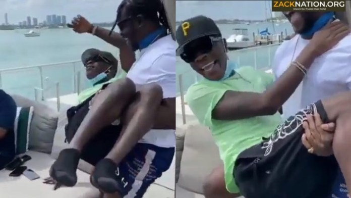 Must Watch: Jupitar carries Shatta Wale like a baby in Miami