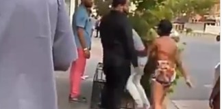 Lady throws many fists at her boyfriend, but he never retaliates.