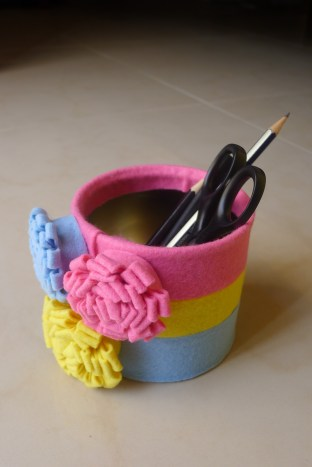 Tin can decorated with felt flowers