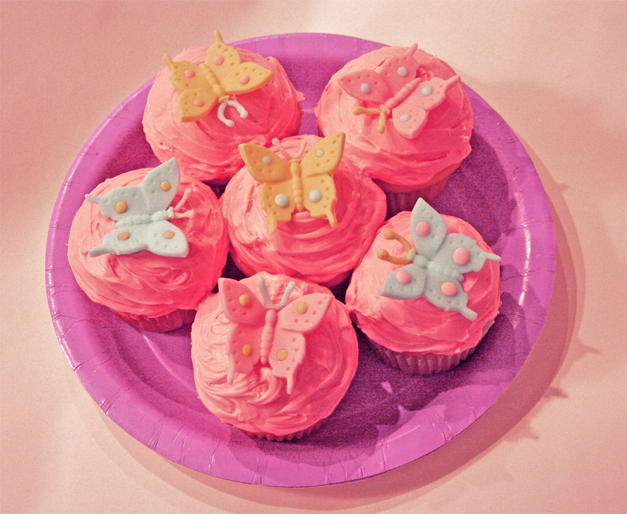 Easy to make Butterfly Cupcakes.  Butterflies are molded from the Kaleidoscope Butterfly Topper/Chocolate/Cookie Mold