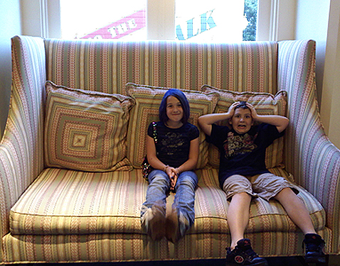 My crazy big kids looking tiny on Disney's Boardwalk Resort's big comfy couch.