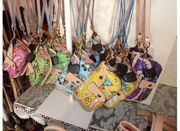 Disney Dooney and Bourke Sketch color wristlets