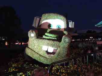 Tow Mater topiary at night