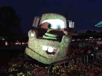 Tow Mater topiary at night