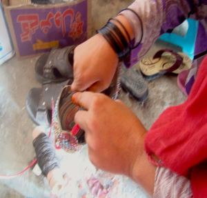 With a small loan, Suhila expanded into a shoe repairing business