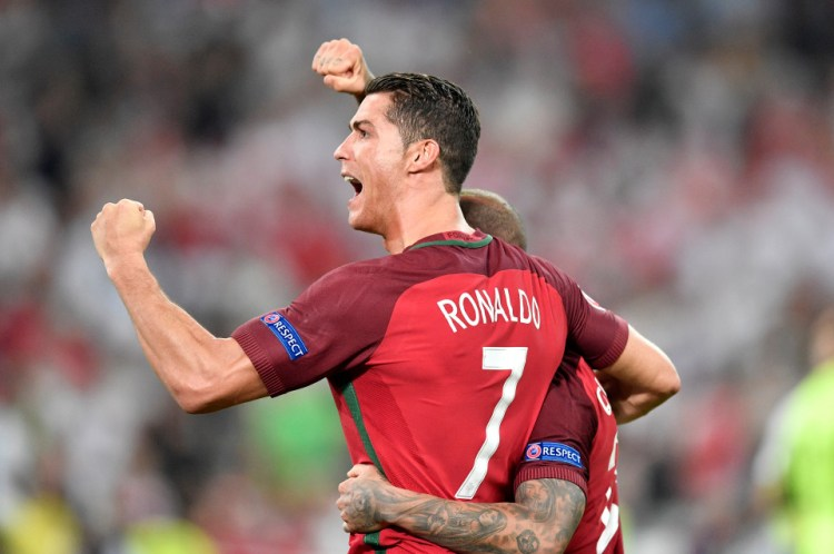 Portugal's Cristiano Ronaldo celebrates after winning the Euro 2016 quarterfinal soccer match between Poland and Portugal, at the Velodrome stadium in Marseille, France, Thursday, June 30, 2016. (AP Photo/Martin Meissner)