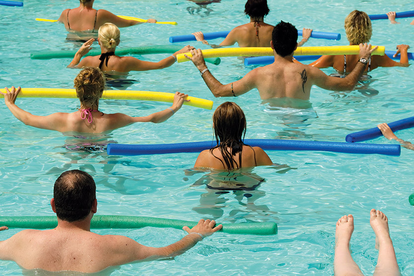 People doing water aerobic in pool