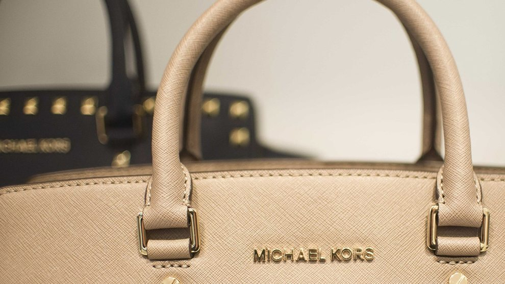 michael kors buying jimmy choo