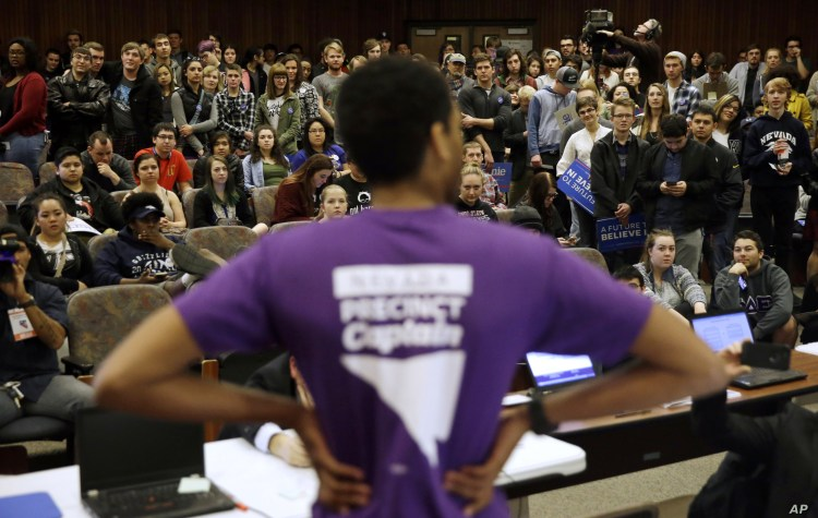 FILE - A precinct captain argues his position during a Democratic caucus at the University of Nevada in Reno, Nevada, Feb. 20, 2016.