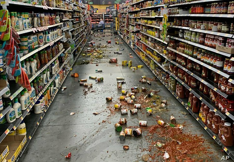 Food that fell from the shelves litters the floor of an aisle at a Walmart following an earthquake in Yucca Yalley, Calif., 155 miles from Ridgecrest, where a magnitude 7.1 quake struck,  July 5, 2019.