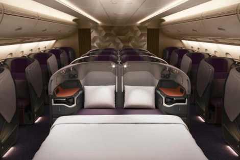 Byznys třída v novém, velkou změnou je především možnost spojení dvou plně rozložitelných sedaček v jedno dvojlůžko v prostřední řadě. Foto: Singapore Airlines