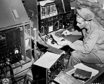 Photo of radio operator at Dobodura