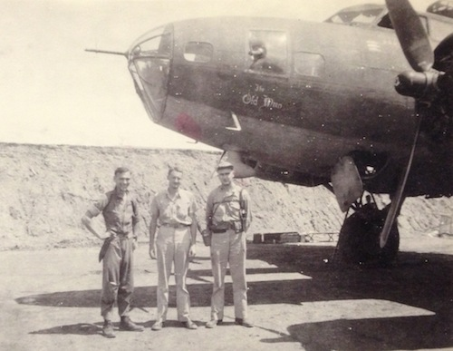 Photo of Zeamer with men and B-17