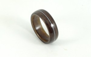 Bent wood ring with guitar string inlay