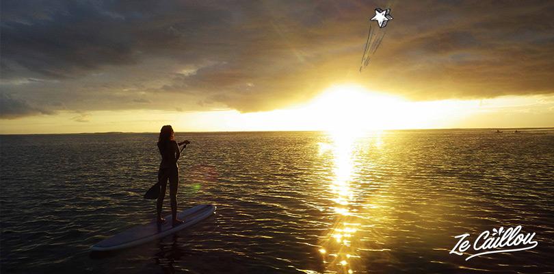 Pratique du paddle à l'ermitage au coucher de soleil à la Réunion