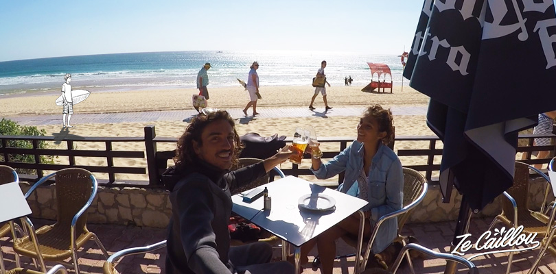 Have a drink after a surf session in Nazare, perfect surf spot in Portugal