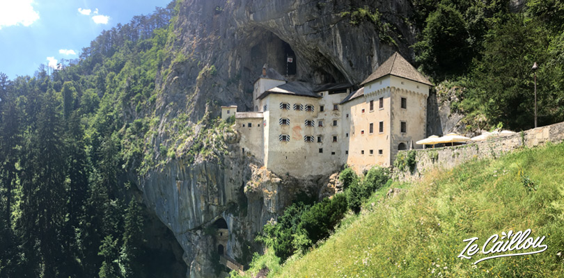 Discover the Predjama castle during your roadtrip in Slovenia with a van.