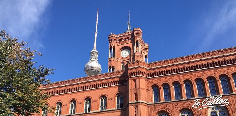 The red bricks town hall in the Mitte district of Berlin with a van.