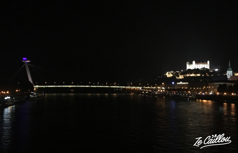 Night view on Bratislava old town, ufo bridge and the castle in Slovakia by van.